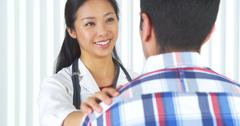 Chinese doctor telling patient the good news Stock Photos