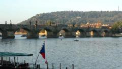 Charles bridge with park (forest) - boat with czech flag Stock Footage