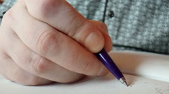Closeup hands writing in diary - stock footage