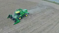 Aerial view of combine harvesting soybean crop Stock Footage