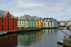 Norway, Alesund, Houses next to canal Stock Photos