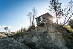 Derelict shack on cliff - stock photo