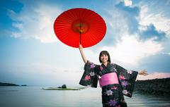 Japan, Okinawa, Happy Japanese woman in Kimono - stock photo