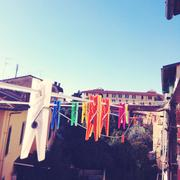 Italia, Tuscany, Firenze, Clothespins on clothesline - stock photo