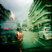 UK, London, Westminster, Knightsbridge, Taxi and car in wet weather Stock Photos