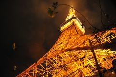 Japan, Kita-Katsushika, Minato, Tokyo Tower shining on rainy night Stock Photos