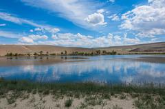 lake steppe sky clouds mountains - stock photo
