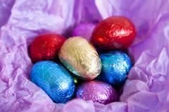 Multi colored foil covered easter eggs Stock Photos