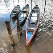 Brazil, Amazonas, Canoes in Amazon river Stock Photos