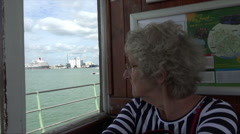 Senior woman enjoys ride on hythe pier railway for southampton ferry Stock Footage