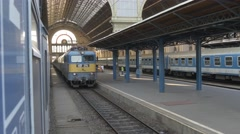 Leaving main train station Budapest Keleti by train 4K view back Stock Footage