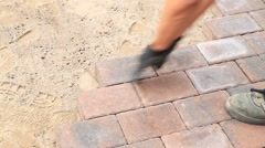 Laying  paving stones Stock Footage