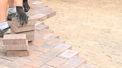 Laying  paving stones - stock footage