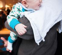 UK Close Up Of Baby On Adults Shoulder - stock photo