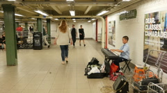 0537 Young very clever piano musician in the subway - stock footage