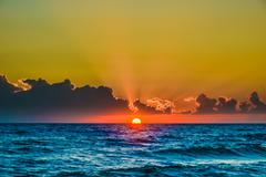 dawn sun tranquil calm sea - stock photo