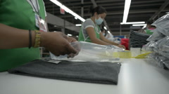 Garment workers preparing and folding clothes - stock footage