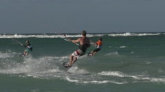 Kids kitesurfing with father Stock Footage
