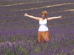 France, Alpes-de-Haute-Provence, Digne-les-Bains, Valensole, Happy woman in Stock Photos