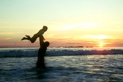 South Africa, Western Cape, Cape Town, Silhouette of father and daughter (4-5) Stock Photos