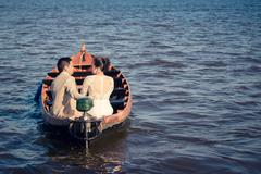 Netherlands, Rear view of couple during boat trip - stock photo