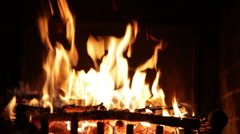Bright flame of fire in an ancient fireplace - stock footage