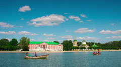 Vacationers go boating about Kuskovo palace.Moscow, Russia Stock Footage