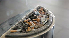 Stub from a cigarette smokes in an ashtray Stock Footage