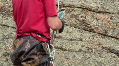 Man trains to conquer the rock Stock Footage