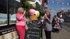 Women enjoy an ice cream at forest glade ice-cream shop, lyndhurst, england Stock Footage