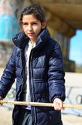 Spain, Barcelona, Girl (8-9) wearing anorak - stock photo