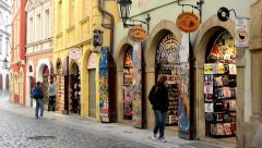 urban vintage street - souvenir shops - walking people - stock footage