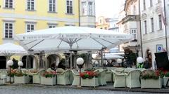 Urban street (city) - exterior restaurant empty outdoor seating - people Stock Footage