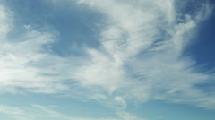 spindrift clouds on blue sky - stock footage