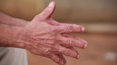 Wrinkled Hands of an Old Man Stock Footage