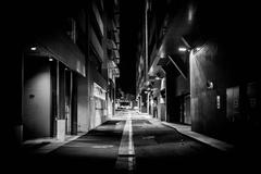 Australia, Canberra, Acton, Street lights illuminate alley at night time. Stock Photos