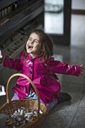 Little girl (4-5) screaming by basket of cosmetics Stock Photos