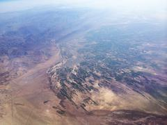 Aerial view of agricultural fields and mountains - stock photo