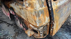 The rusty and burned-down body of a car Stock Footage