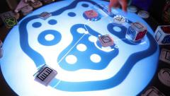Musician uses reacTable - electroacoustic electronic musical instrument. Stock Footage