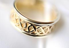Close-up of engraved wedding ring - stock photo
