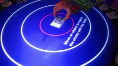 Stock Video Footage of Musician uses reacTable - electroacoustic electronic musical instrument.
