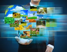 businessman holding green earth in hands and reaching images streaming .envir - stock illustration