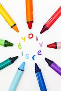 Crayons surrounding the word diversity Stock Photos