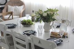Stock Photo of Dining table set for lunch with crockery