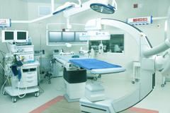 Operating room with robotic imaging system Stock Photos