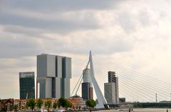 Netherlands, Rotterdam, Skyline against moody sky - stock photo