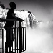 Brazil, Man looking at mighty waterfalls of Iguazu Stock Photos