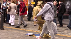 Street artist suspended and spectators Stock Footage
