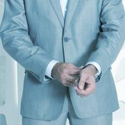 Stock Photo of Businessman adjusting his shirt cuff